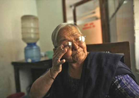 Kamla Devi, 55, an employee who has served for 30 years, cries as she talks about her career, inside the Central Telegraph Office in New Delhi July 10, 2013.