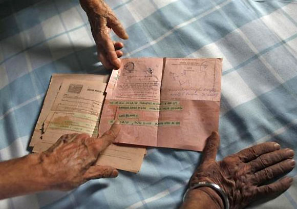 Surjeet Kaur, 77, displays a telegram which was sent to her son by her daughter-in-law in 1978, inside her house in New Delhi July 9, 2013.
