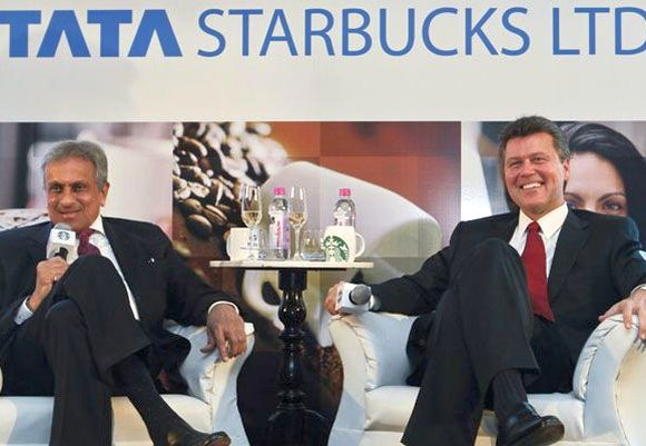 Vice Chairman of Tata Global Beverages R.K. Krishna Kumar and President of Starbucks China and Asia Pacific John Culver (R).