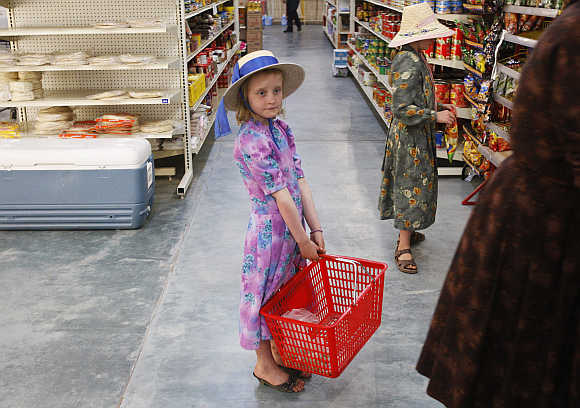 A girls holds a basket at a supermarket at the Mennonite community of Buenos Aires in the northern Mexican state of Chihuahua.