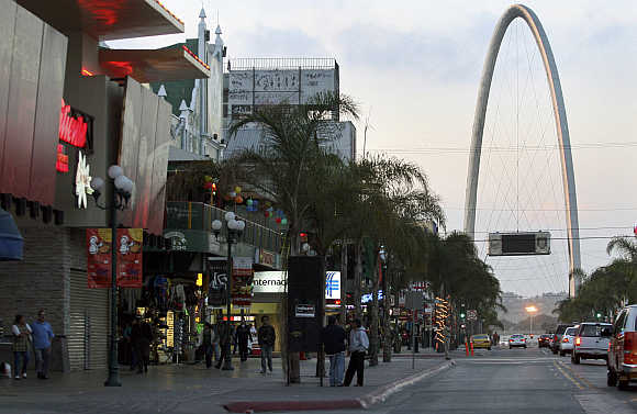 People walk at the Revolucion avenue in the border city of Tijuana, Mexico.