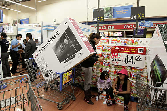 Customers at a Walmart store in Mexico City.