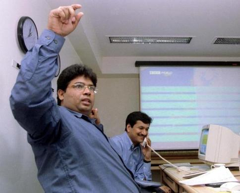 Stock brokers trade in Mumbai, July 5, 1999.