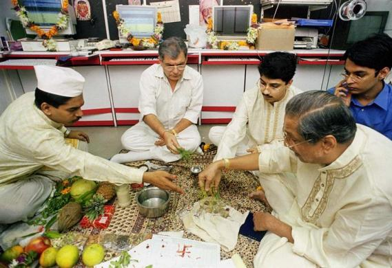 Brokers perform a traditional prayer ritual on the occasion of Diwali in Mumbai, November 7.