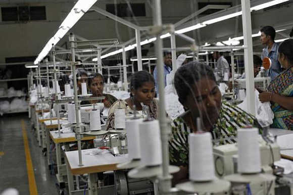 Employees sew clothes at the Estee garment factory in Tirupur, Tamil Nadu
