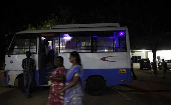 Employees leave the Estee garment factory after their day's work in Tirupur, Tamil Nadu.