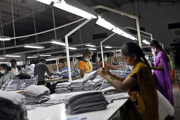 Employees sort clothes before packing them at the Estee garment factory in Tirupur, Tamil Nadu.