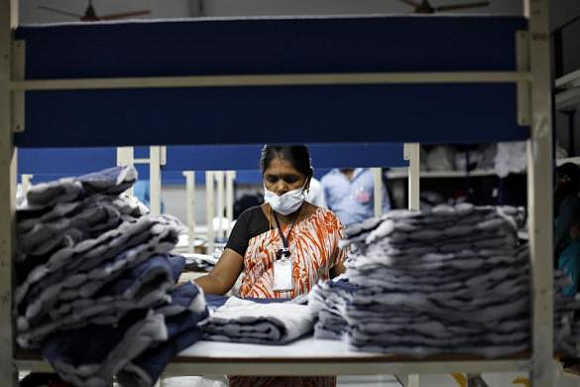 An employee sorts pieces of cloth at the Estee garment factory in Tirupur, Tamil Nadu.