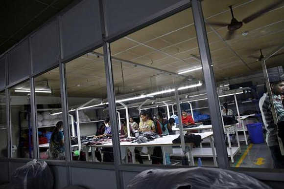 Employees work at the Estee garment factory in Tirupur, Tamil Nadu.