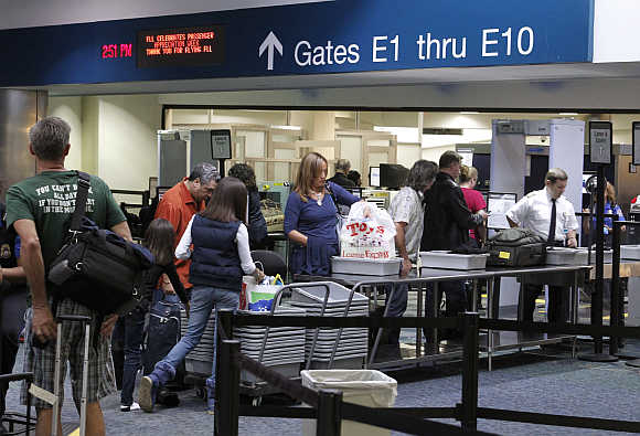 Passengers line up at a security checkpoint operated by the Transportation Security Administration at Fort Lauderdale-Hollywood International Airport in Fort Lauderdale, Florida.