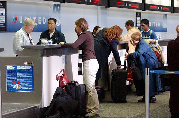 United Airlines employees assist customers at San Francisco International Airport in San Francisco, California.