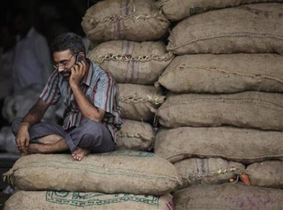 A trader talks on his phone.