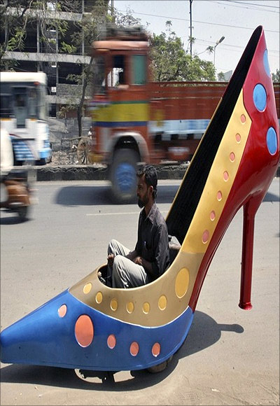 A car in the shape of a high-heel shoe gets a road test in Hyderabad.