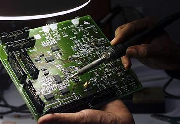 A semiconductor chip designer works on a computer component in Bangalore.