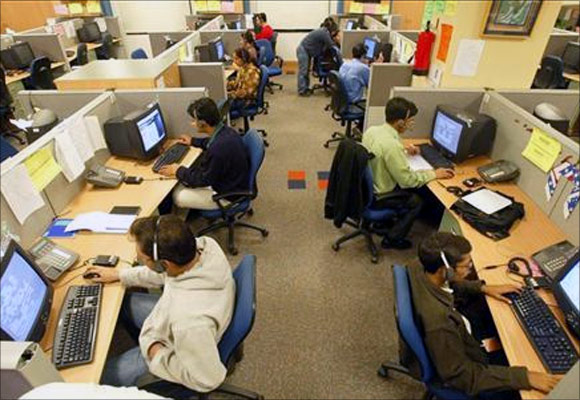 Indian engineers attend to calls from abroad inside a call centre in Gurgaon on the outskirts of New Delhi.