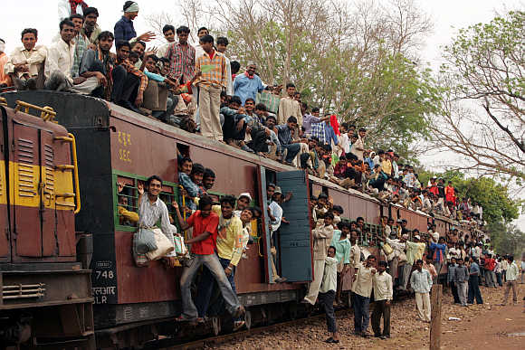 Passengers on a train on the outskirts of Raipur.