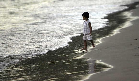 A child walks on a beach in Port Blair.