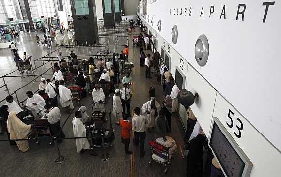Passengers wait at the check-in hall at Bangalore International Airport.