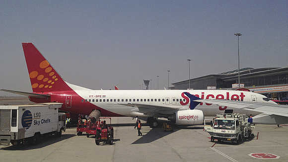 A SpiceJet Boeing 737-800 aircraft is parked at Hyderabad airport.