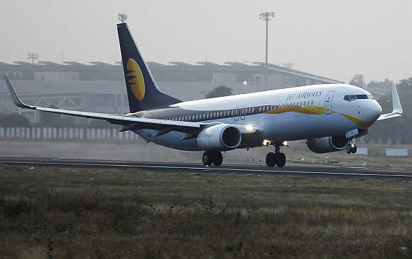 A Jet Airways passenger plane takes off from Ahmedabad airport.