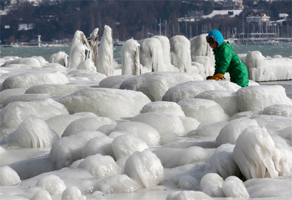 Children play in the icy aftermath of a snowstorm on the banks of Lake Leman in Geneva, Switzerland.