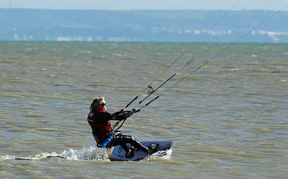 Richard Branson kitesurfs to test conditions in the English Channel at Dungeness, in south east England.