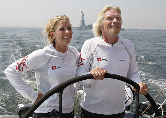 Richard Branson and his daughter Holly sail on the boat 'Virgin Money', as it goes out for a sea trial in New York harbor near the Statue of Liberty.