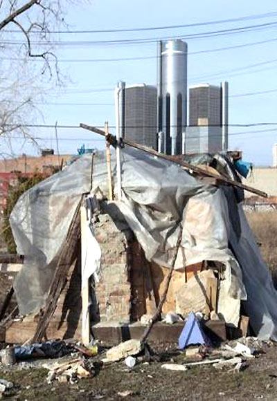 A makeshift homeless people's structure is seen with the General Motors world headquarters in the background in Detroit.