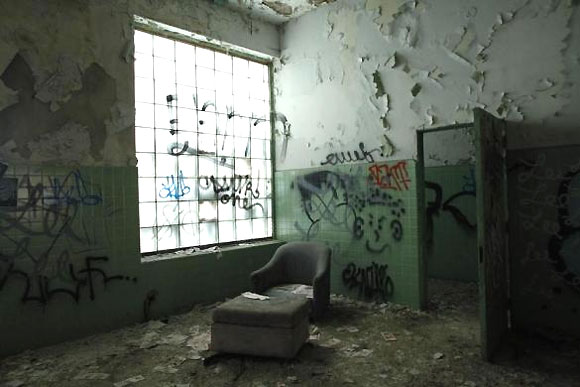 A chair is seen inside the abandoned and decaying manufacturing plant of Packard Motor Car in Detroit.