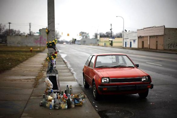 A car is seen next a memorial in Detroit.