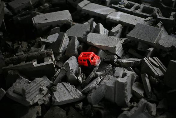 A child's toy is seen in a pile of concrete blocks inside the abandoned and decaying Packard Motor Car Manufacturing Plant.