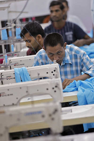 Workers sew clothes at a garment factory in New Delhi.