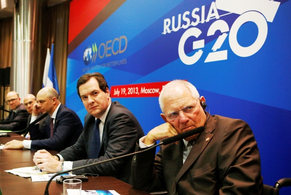 (From R-L) Germany's Finance Minister Wolfgang Schaeuble, Britain's Chancellor of the Exchequer George Osborne, Russia's Finance Minister Anton Siluanov, Angel Gurria, secretary-general of the Organisation for Economic Co-operation and Development, and France's Finance Minister Pierre Moscovici attend a news conference, part of the G20 finance ministers and central bank governors' meeting, in Moscow, July 19, 2013.