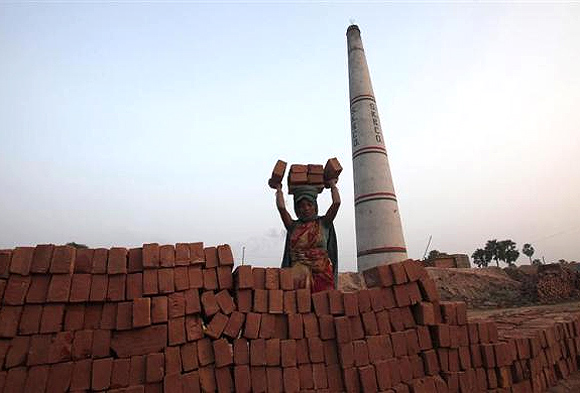 A labourer works at a brick factory at Hajipur industrial park on the outskirts of Patna, in Bihar.