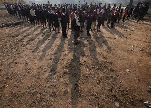 School children stand during the morning prayer at a school in Anandpur near Patna, in Bihar.