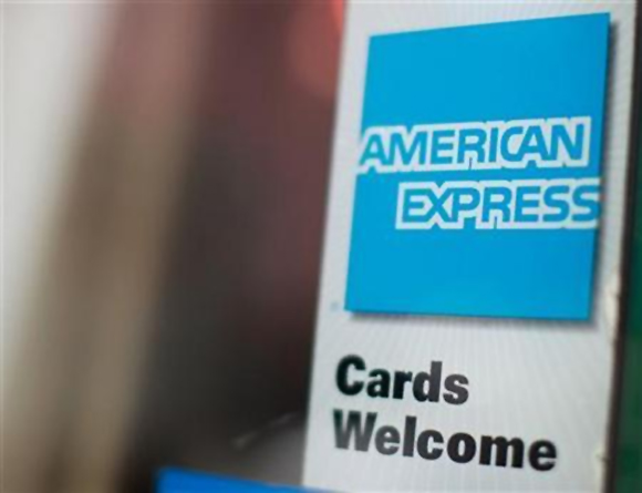 An American Express sign is seen on a restaurant door in New York.