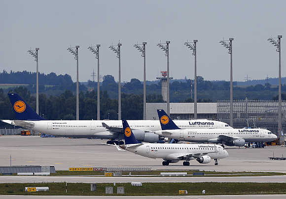 Lufthansa planes stand on the tarmac at Munich's international airport in Germany.
