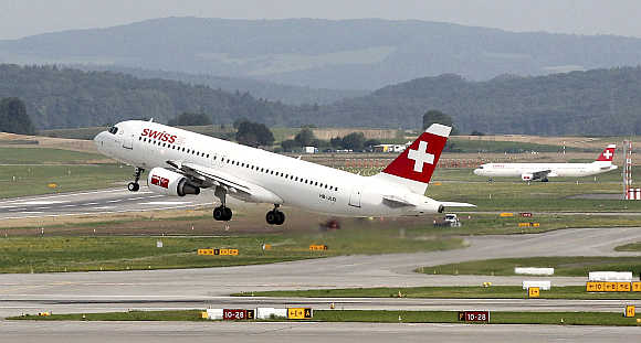 An Airbus A320-214 HB-JLQ of Swiss airlines takes off from the airport in Zurich, Switzerland.