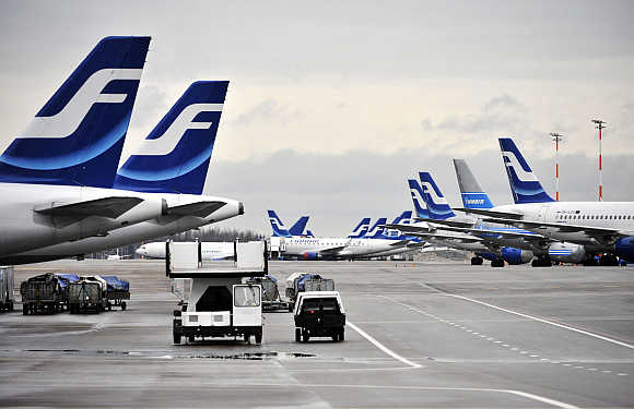 Passenger planes of Finnish national airline Finnair stand on the tarmac of Helsinki international airport in Finland.