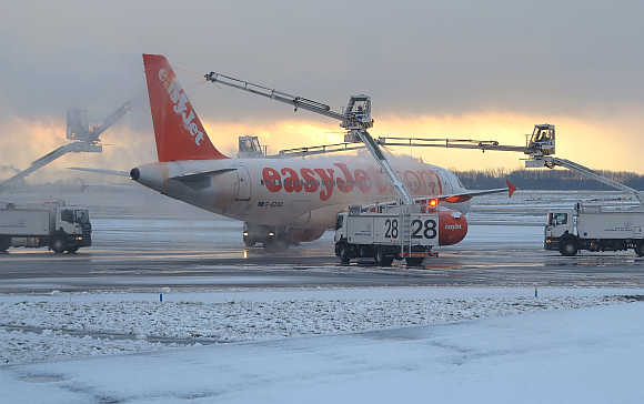An Easyjet plane is de-iced on a runway at the Roissy Charles De Gaulle airport near Paris.