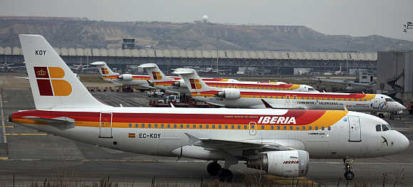 An Iberia passenger plane taxis on the tarmac of Madrid's Barajas airport in Spain.