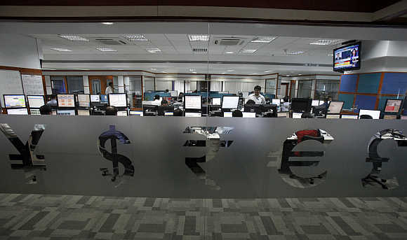 Foreign currency traders inside a firm in Mumbai.