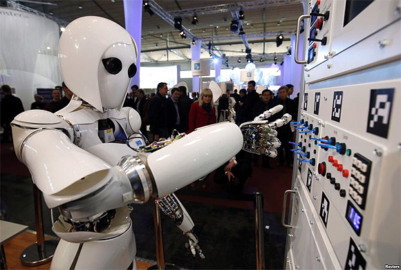 Humanoid robot AILA (artificial intelligence lightweight android) operates a switchboard during a demonstration by the German research centre for artificial intelligence at the CeBit computer fair in Hanover.