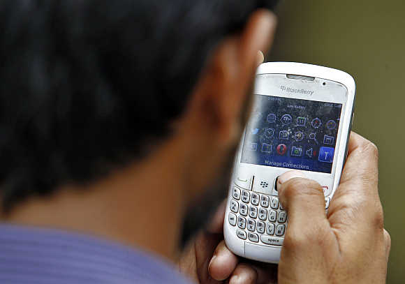 A man checks his mobile phone in New Delhi.