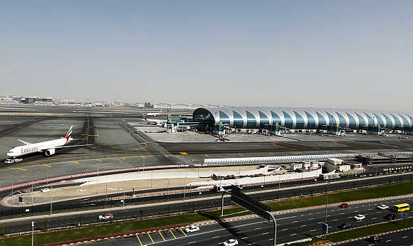 A plane is seen beside the terminal dedicated for A380 aircraft at the concourse in Dubai International Airport.