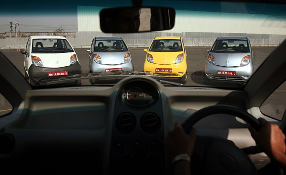 Tata Motors Nano cars are displayed before a test drive session.