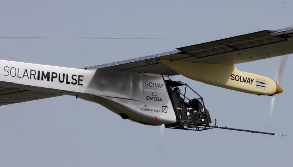 German test pilot Markus Scherdel steers the solar-powered Solar Impulse HB-SIA prototype airplane during his first flight over Payerne.