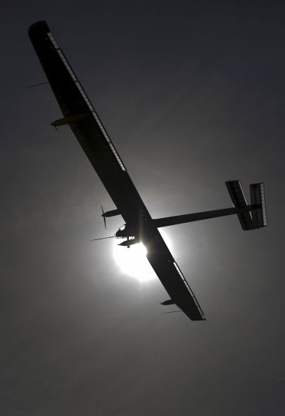 German test pilot Markus Scherdel steers the solar-powered Solar Impulse HB-SIA prototype airplane during his first flight over Payerne