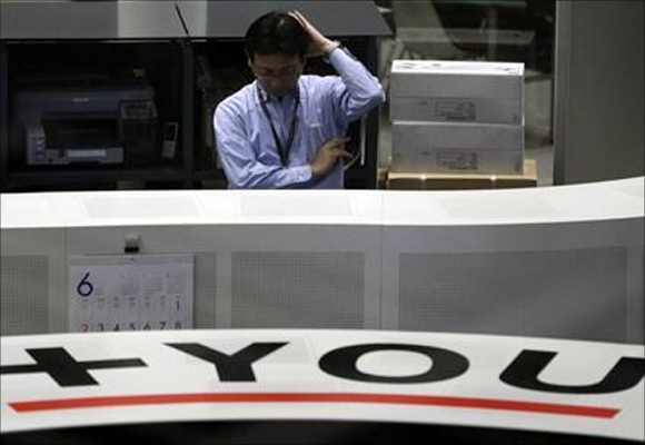 An employee works at the Tokyo Stock Exchange.