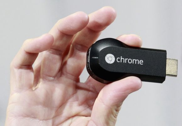 Mario Queiroz, vice president of product management, holds the new Google Chromecast dongle as it is announced during a Google event at Dogpatch Studio in San Francisco.